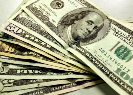 Dólar cai pela primeira vez em três dias e fecha a R$ 5,58